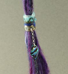 Seashell dread bead, ocean wave hair bead with dangly bit, dreads bead ocean theme. $13.00, via Etsy.