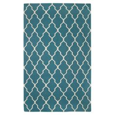 Hand-woven New Zealand wool rug with a trellis motif.   Product: RugConstruction Material: New Zealand wool...