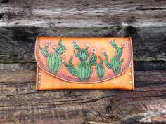 Custom Tooled Leather Clutch by 76andRiveted on Etsy https://www.etsy.com/listing/261729155/custom-tooled-leather-clutch