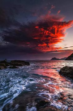 Epic red clouds on the bustling waters