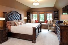 Fairytale Tudor traditional bedroom. Headboard is too heavy but like layout, built ins, etc.