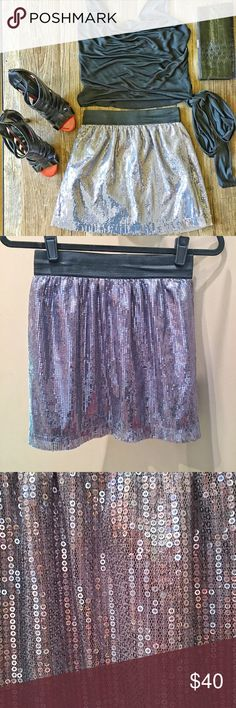 ✨NWT HP ✨ Romeo & Juliet Couture sequin skirt Brilliant silver sequin miniskirt from Romeo & Juliet Couture. Elastic waistband with bright silver sequins and a silver lining. New with tags! Romeo & Juliet Couture Skirts Mini