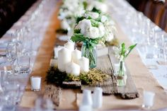 something along this line..but with lace and colored flowers and mason jars lol