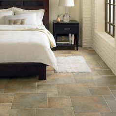 Porcelain Tile - Porcelain Slate Tile Look - Mannington Flooring With its worn edges, rustic patina, and weathered texture, Antiquity is an epitomization of all the characteristics for which it was named.  It looks as if time has embraced and beautified it.