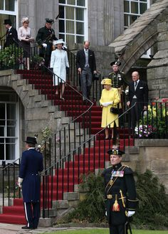Queen Elizabeth II and the Duke of Edinburgh arriving at the Palace of Holyrood House for the annual garden party