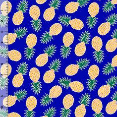Tossed Pineapples on Royal Blue Cotton Jersey Blend Knit Fabric