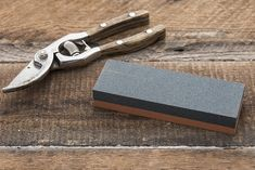 Keeps Tools Sharp and Efficient. Our handy sharpener gives your old tools a new edge. Simply soak the whetstone in water and run it along the tool's edge. Old Tools, Yard Design, Garden Gifts, Decorative Accessories, Loafers Men, Garden Tools, Oxford Shoes, Garden Products, Gardening Tips