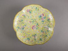 19th Century Chinese porcelain stem plate; of lobed form with interior decorated with chrysanthemum sprays on yellow ground; six-character Tongzhi Mark and of the Period; H: 5 cm, D: 19 cm