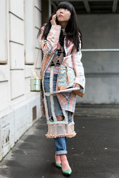 Couture Fashion Week street style — Susie Bubble's cutout plaid layers would be better suited for the runway than the street.