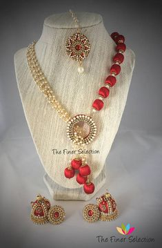 Beautiful and adorned silk thread necklace set!! Grand and ornate red Silk thread beads and artificial pearl necklace set.Necklace comes along with grand red earrings(jhumkas) in medium size. This set comes along with a beautiful pearl work tikka. We try to do our best to