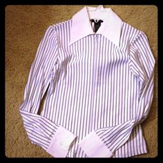 Express white and black pinstripe dress shirt Beautiful pinstripe shirt. It is 81% nylon, 13% polyester and 6% spandex- so it never needs ironed!! It is very flattering for work. The zipper allows you to determine just how much cleavage shows- and don't have to worry about anyone looking through button holes! Express Tops