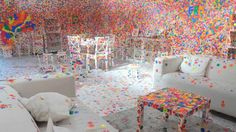 This is what happens when you give thousands of stickers to thousands of kids - TateShots: Kusama's Obliteration Room
