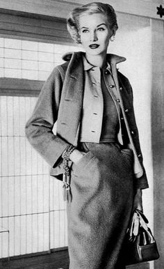 1954 Sunny Harnett in camel colored fleece jacket and skirt worn over beige jersey shirt-jacket worn over worsted jersey T-shirt by Claire McCardell, photo by Irving Penn