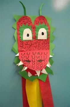 A dragon craft made of paper and streamers for Chinese New Year.