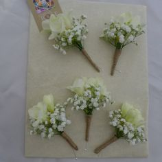 Boutonnieres of gypsophila and freesia