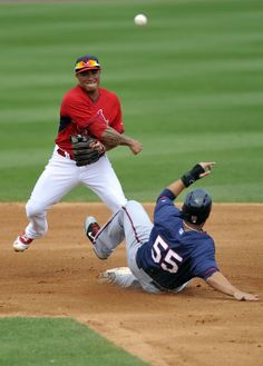 Mar 19, 2014; Jupiter, FL, USA; Minnesota Twins first baseman Chris Colabello (55) is forced out at second base by St. Louis Cardinals second baseman Kolten Wong (16) during a game at Roger Dean Stadium. Mandatory Credit: Steve Mitchell-USA TODAY Sports