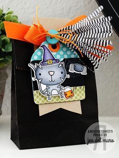 Halloween Treat bag by Jen del Muro. Reverse Confetti stamp set: Too Cute to Spook. Confetti Cuts: Too Cute to Spook, Folded Tag and  Tassel (used to make stripped tissue pieces). Halloween favor.