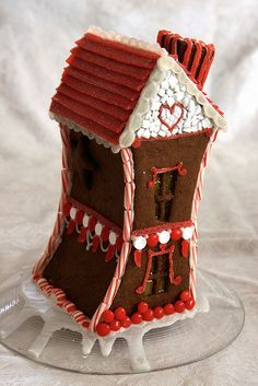 topsy-turvy gingerbread house by khelanew, via Flickr