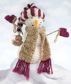 "Crochetworld.com~   Snowman is singing: ""In the arms of an Angel"""