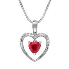 Heart Shaped Ruby and Diamond Heart Pendant (18 in.) One sparkling heart-shaped ruby, at approximately .59 carat, is the highlight of this beautiful 14 karat white gold heart pendant. Seventeen round diamonds line the top of the heart at approximately .10 carat total weight. The pendant hangs from a matching 14 karat white gold 18-inch box chain. The total gem weight is approximately .69 carat. #ShaneCoLBD