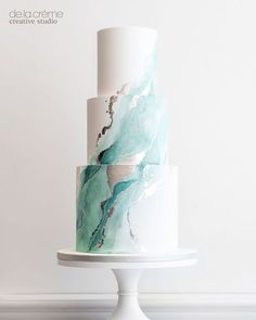 What a watercolor beauty! It may be minimalistic, but the hand painted details with silver leaf veining was epic! Inside, we had Amaretto… Fancy Cakes, Mini Cakes, Cupcake Cakes, Cupcakes, Pretty Cakes, Beautiful Cakes, Amazing Cakes, Creative Studio, Wedding Cake Designs