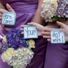 Have your bridesmaids flash your groom a message right before you walk down the aisle!