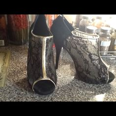 Beautiful sexy stilettos black lace gold 7 Bought it from Avon!! Too high for me! Great for a party, wedding, willing to accept reasonable offers! So make an offer! These are beautiful!! Brand New! NO TRADES AVON Shoes Heels