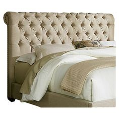 Lend a touch of elegant style to your master suite or guest room with this lovely upholstered bed, showcasing a button-tufted headboard and sleigh design.
