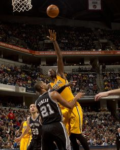 Roy Hibbert puts it up over the San Antonio Spurs' Tim Duncan in their November 23, 2012 match-up at Bankers Life Fieldhouse