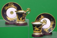 PAIR NYMPHENBURG CUPS/SAUCERS
