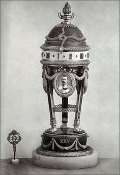 Original picture of the Youssoupov Egg.  1907 Yusopov Egg - presented by Prince Felix Yusopov to his wife for their 25th wedding anniversary. Suspended laurel swags once held miniatures of Prince Felix and his two sons, but were replaced with the initials of the second owner of the piece.