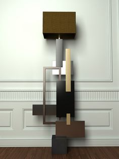 FLOOR LAMPS / MONDRIAN  Floor lamp, body made of different materials sheets among which: wengè wood, brass with differents finishing, slate base.  Product handmade by master craftsmen.  Any imperfections are essence of the manual work's process and characterize the uniqueness of each creation.