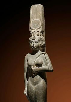 Princess with Nubian wig. Ankhnesneferibre was the daughter of Psamtik II,a pharaoh of the 26th Dynasty (6th century B.C.), which was based in the Delta town of Saite. Ankhnesneferibre was sent to Thebes to hold the office of 'God's Wife of Amun', which was the highest office in the priesthood of the temple of Amun in Karnak.She is wearing a socalled Nubian wig,a headdress that is built up of layers of tightly curled plaits and which is thought to imitate the thick hairstyles of the Nubian…