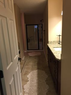 Master bathroom remodel featuring porcelain tile with oil rubbed ...