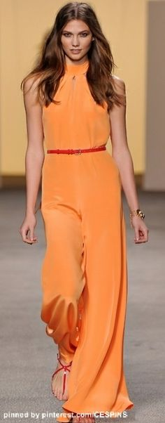 Love the red accessories with  this apricot tone jumpsuit!