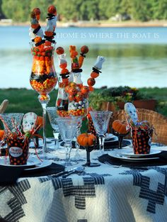 Cutest Halloween Centerpieces--colorful candy layered in glassware topped with skewered candy.