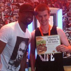 Dwayne Wade posing with a Triple King Winner at Fatburger!