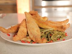 Get Emeril Lagasse's Nashville Fried Catfish with Southern-Style Green Beans with Bacon and New Potatoes Recipe from Cooking Channel