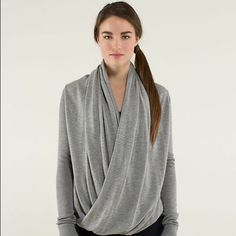 Lululemon Iconic Sweater  Lululemon Iconic Wrap sweater Heathered Medium light grey /grey stripe sz 4 exclusive photos coming soon excellent condition Icon Wrap we designed this soft, transformable wrap to keep us cozy on our way to the studio. Boolux  fabric blends rayon from bamboo with TENCEL and cashmere for added warmth wear, wrap long in the front or flip it upside down for crop fit thumbholes help keep your sleeves down and hands warm loose fit lululemon athletica Sweaters Cowl…
