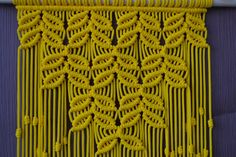 Wall panels handmade macramé technique. Material: 100% polyester. Color: yellow. Strap: natural wood - pine. Dimensions: The length from the wooden plank to the bottom, including the thread - 80cm / 31.5 inches Width - 33cm / 13 inches