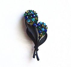 Hey, I found this really awesome Etsy listing at https://www.etsy.com/listing/467960177/blue-green-rhinestone-brooch-vintage