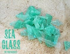 Make glass candy (add blue curaçao for a pretty color!): 2 cups water, 1 cup white corn syrup, 3 1/2 cups sugar, 1/4 tsp cream of tartar, Then add 1/4 tsp vanilla extract, 3 drops of blue gel food coloring. Boil the mixture, then continue stirring it until it reaches 300 degrees F (used a candy thermometer to measure the temp). Pour it into a try to cool, then smash to pieces!