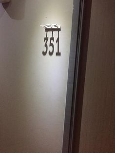 My hotel room number is created by a shadow : mildlyinteresting
