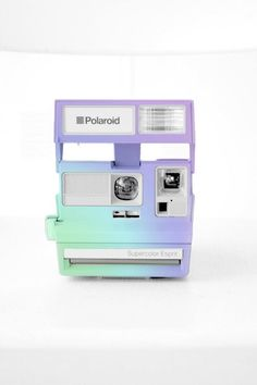 I want a Polaroid! This would be cute though for like guests to take pictures at a wedding with...