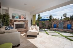 Nano sliders open up this Huntington Beach living room to the patio for the ultimate indoor/outdoor experience.