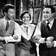 """Debbie Reynolds, with """"Singin' in the Rain"""" co-stars Donald O'Connor (left) and Gene Kelly, will introduce a 60th-anniversary restoration of the film at the Turner Classic Film Festival."""