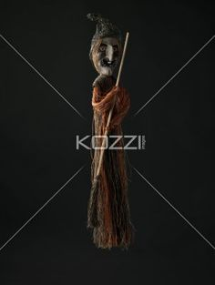 view pf  witch holding broom. - View pf  witch holding broom against black background.