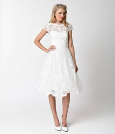 An angelic dream from Chi Chi London, the Aerin in the perfect bridal dress for the vintage minded dame! Cut in a retro 1950s style silhouette, this gorgeous piece exudes grace with a white mesh overlay, embellished with soft embroidered lace accents in o