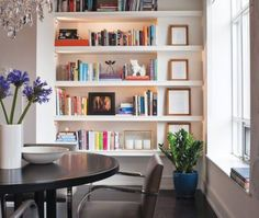 Love the layout with the bookshelves and the round table.