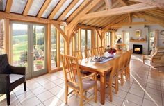 Simple open-plan living space with traditional green oak frame. By Roderick James Architects. Timber Frames, Timber Frame Homes, Room Kitchen, Dining Room, Oak Framed Extensions, Devon House, Newton Abbot, Timber Architecture, Glazed Doors